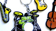 Music design keyrings featuring instruments, clefs and music notes.